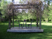 Sitting area under an arbor